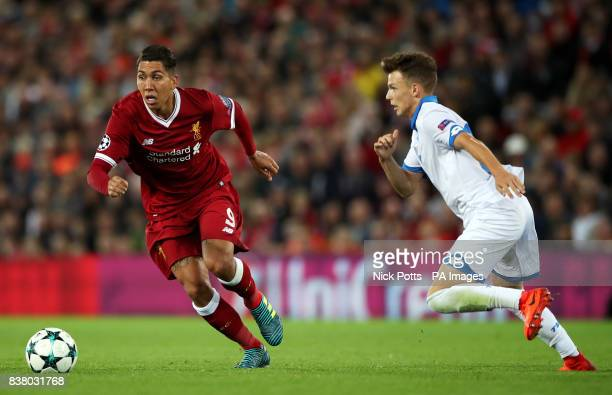 Liverpool's Roberto Firmino and Hoffenheim's Dennis Geiger in action during the UEFA Champions League PlayOff Second Leg match at Anfield Liverpool