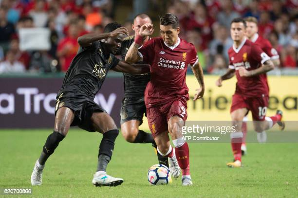 Liverpool's Roberto Firmino and Leicester City's Daniel Amartey compete for the ball during the final of the Premier League Asia Trophy football...