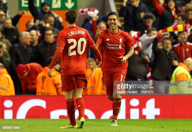 Liverpool's Roberto Firmino celebrates with teammate Adam Lallana after scoring his side's second goal