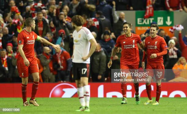 Liverpool's Roberto Firmino celebrates with teammates Adam Lallana and Jordan Henderson after scoring his side's second goal