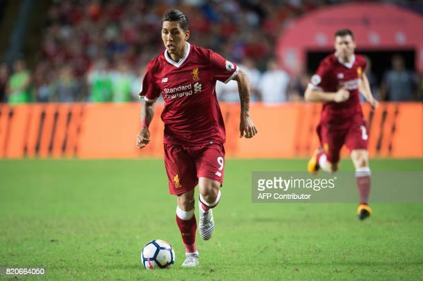 Liverpool's Roberto Firmino controls the ball during the final of the Premier League Asia Trophy football tournament between Liverpool and Leicester...