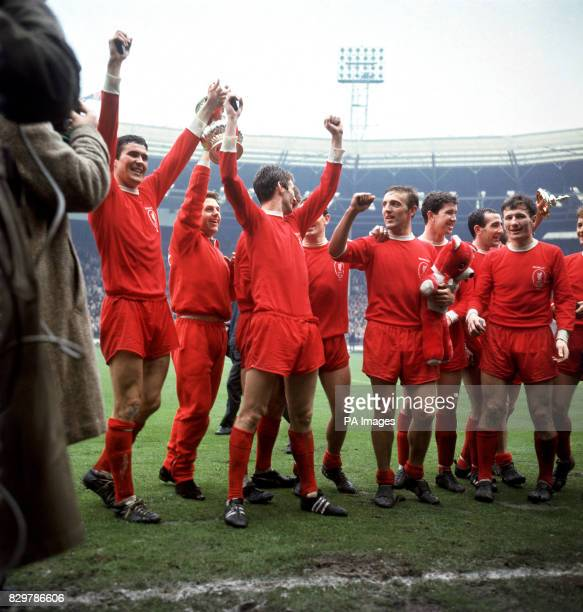 Liverpool's Ron Yeats Gordon Milne Wilf Stevenson Ian St John Peter Thompson Chris Lawler Gerry Byrne and Tommy Smith celebrate with the FA Cup after...