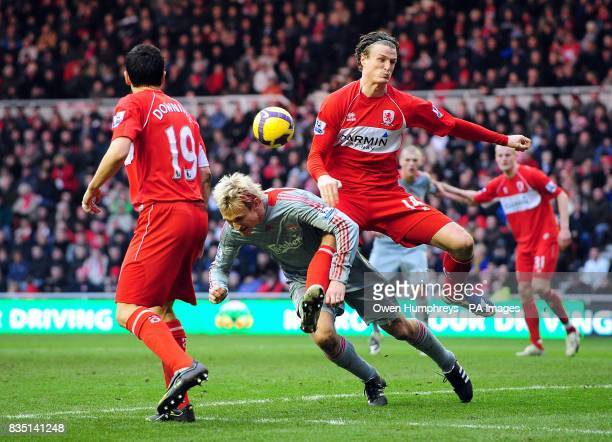 Liverpool's Sami Hyypia and Middlesbrough's Robert Huth battle for the ball