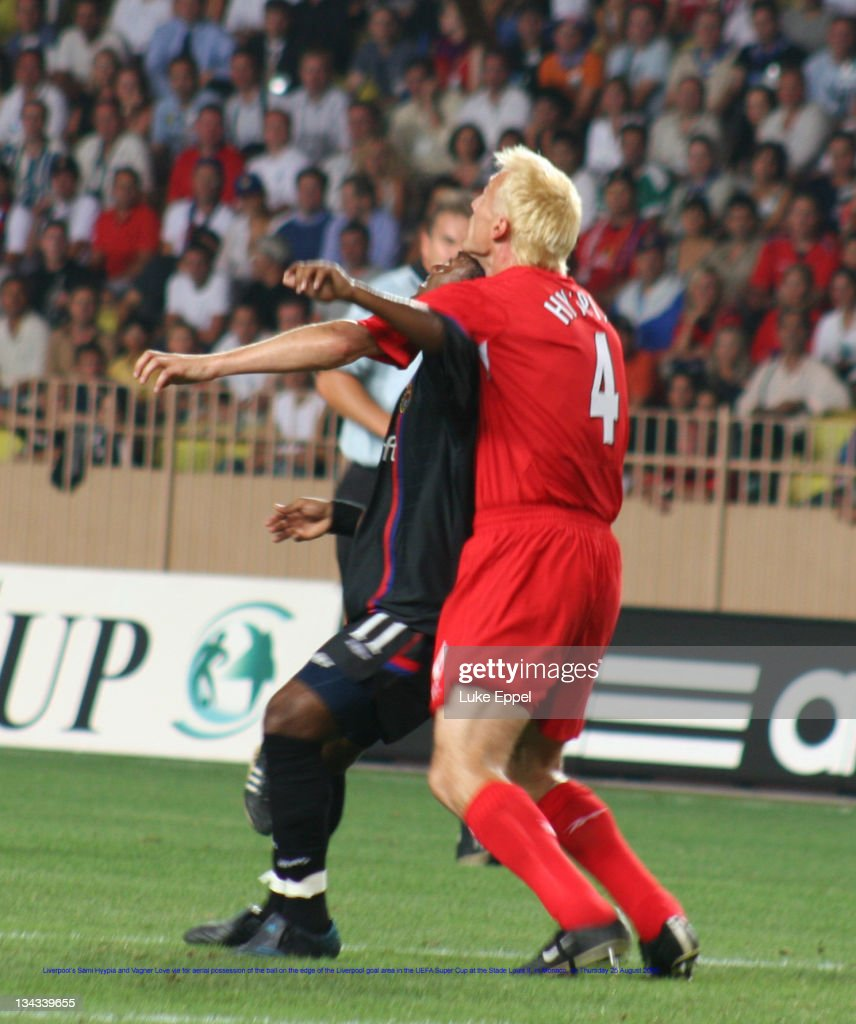 Liverpool's Sami Hyypia and Vagner Love vie for aerial possession of the ball on the edge of the Liverpool goal area in the UEFA Super Cup at the...