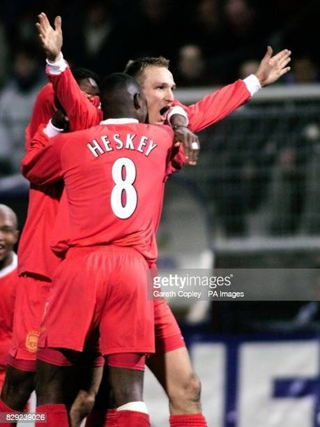 Liverpool's Sami Hyypia celebrates with teammate Emile Heskey after scoring the opening goal against Auxerre during the UEFA Cup fourth round first...