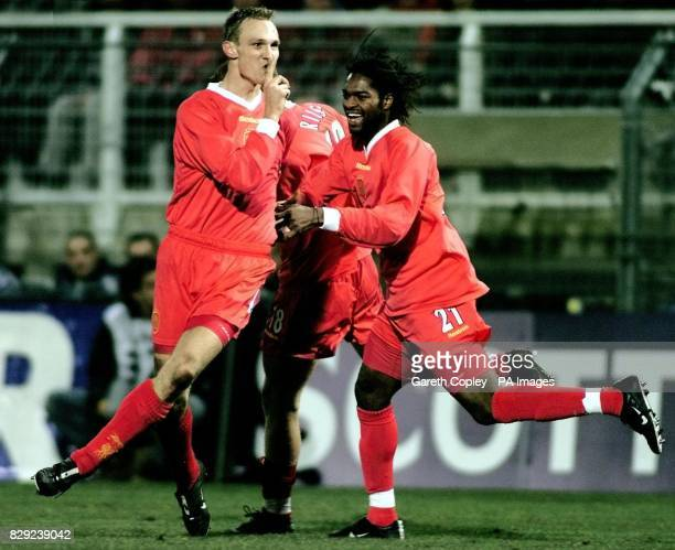 Liverpool's Sami Hyypia celebrates with teammate Salif Diao after scoring the opening goal against Auxerre during the UEFA Cup fourth round first leg...