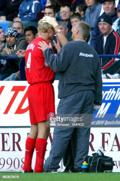 Liverpool's Sami Hyypia gets treatment for a facial injury that led to his early departure from the game