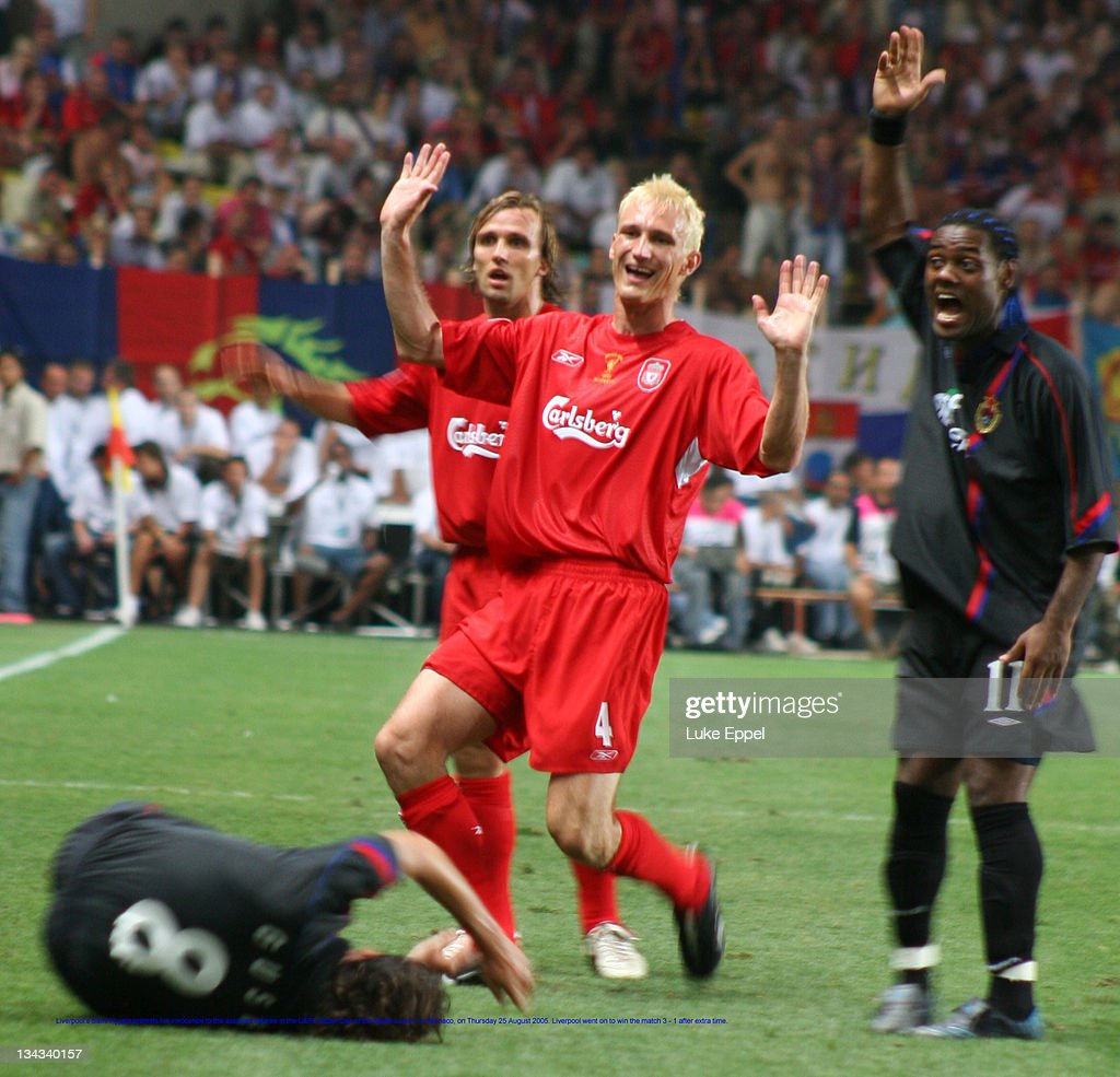 Liverpool's Sami Hyypia protests his innocence to the assistant referee in the UEFA Super Cup at the Stade Louis II, in Monaco, on August 25, 2005. Liverpool went on to win the match 3 - 1 after extra time.