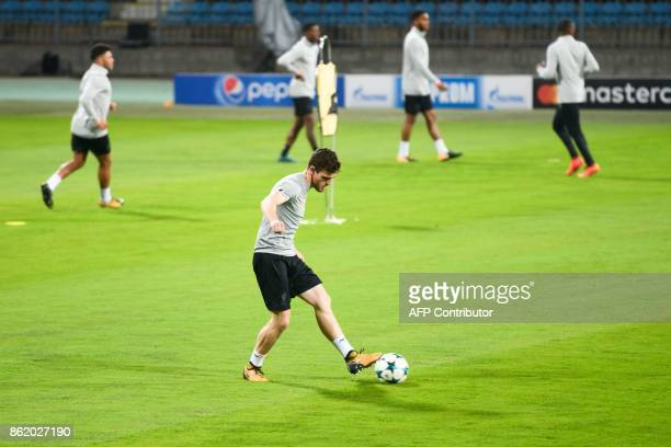 Liverpool's Scottish defender Andrew Robertson plays the ball during a training session on the eve of the UEFA Champions League Group E football...