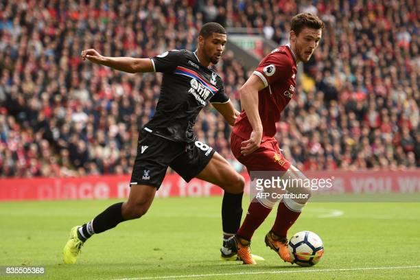 Liverpool's Scottish defender Andrew Robertson vies with Crystal Palace's English midfielder Ruben LoftusCheek during the English Premier League...
