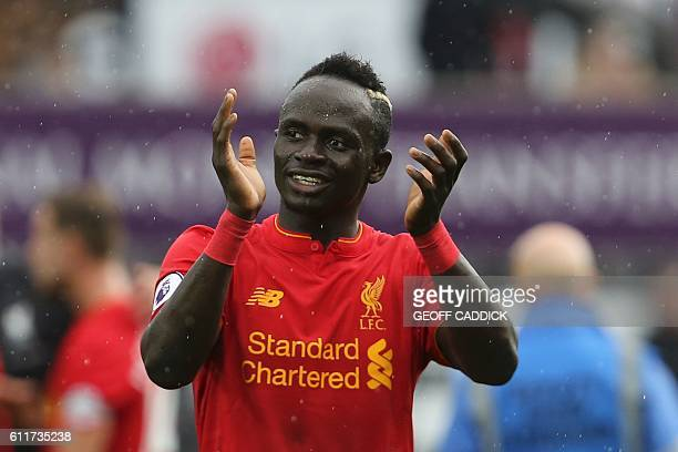 Liverpool's Senegalese midfielder Sadio Mane applauds at the end of the English Premier League football match between Swansea City and Liverpool at...