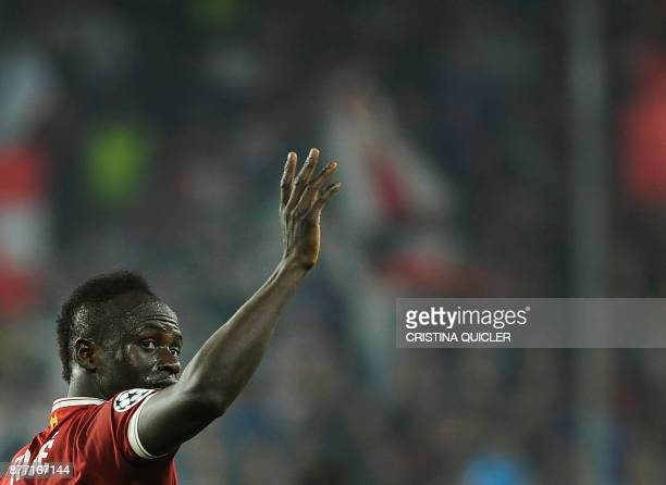 Liverpool's Senegalese midfielder Sadio Mane celebrates after scoring a goal on November 21 2017 at the Ramon Sanchez Pizjuan stadium in Sevilla...