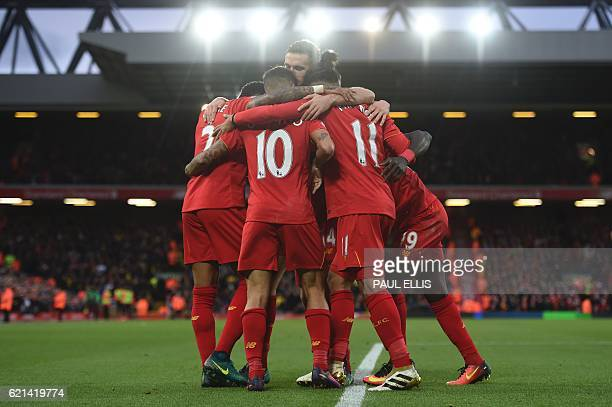 Liverpool's Senegalese midfielder Sadio Mane celebrates scoring his team's fifth goal with Liverpool's Brazilian midfielder Philippe Coutinho and...