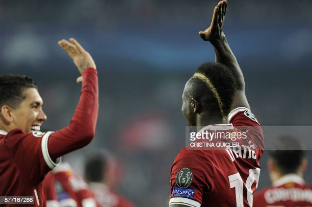Liverpool's Senegalese midfielder Sadio Mane celebrates with Liverpool's Brazilian midfielder Roberto Firmino after scoring a goal on November 21...