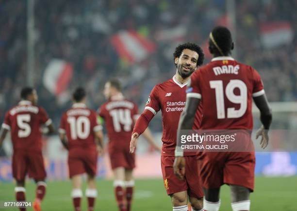 Liverpool's Senegalese midfielder Sadio Mane celebrates with Liverpool's Egyptian midfielder Mohamed Salah after scoring a goal on November 21 2017...