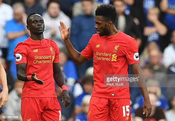 Liverpool's Senegalese midfielder Sadio Mane celebrates with Liverpool's English striker Daniel Sturridge after scoring their second goal during the...