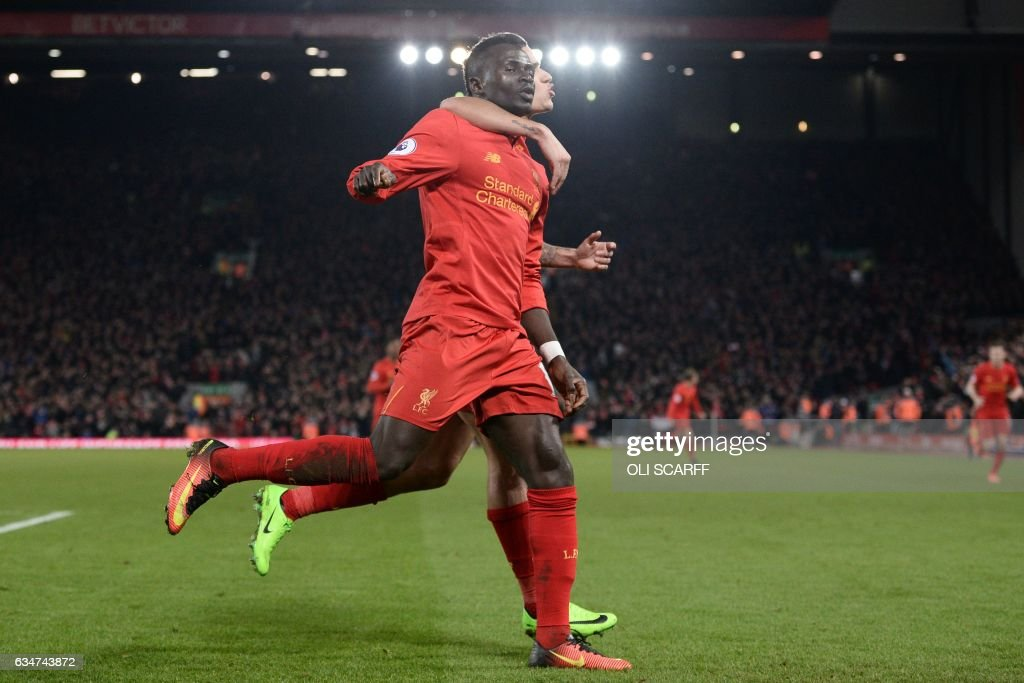 Liverpool's Senegalese midfielder Sadio Mane (L) celebrates with Liverpool's Brazilian midfielder Philippe Coutinho after scoring their second goal during the English Premier League football match between Liverpool and Tottenham Hotspur at Anfield in Liverpool, north west England on February 11, 2017. / AFP / Oli SCARFF / RESTRICTED TO EDITORIAL USE. No use with unauthorized audio, video, data, fixture lists, club/league logos or 'live' services. Online in-match use limited to 75 images, no video emulation. No use in betting, games or single club/league/player publications. /