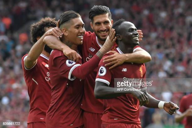 Liverpool's Senegalese midfielder Sadio Mane celebrates with teammates after scoring their second goal during the English Premier League football...