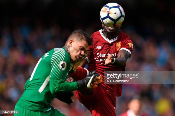 TOPSHOT Liverpool's Senegalese midfielder Sadio Mane challenges Manchester City's Brazilian goalkeeper Ederson a challenge for which he is sent off...
