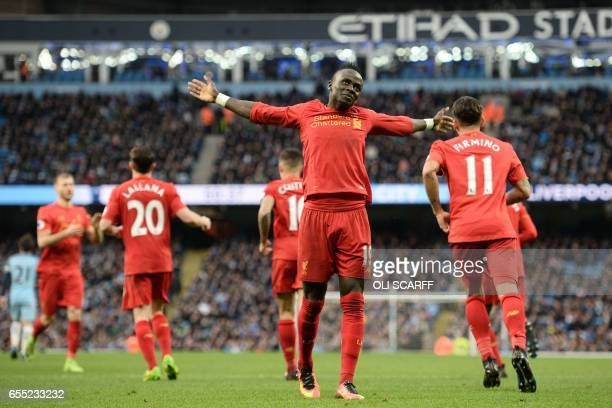 Liverpool's Senegalese midfielder Sadio Mane gestures after Liverpool's English midfielder James Milner opens the scoring from the penalty spot...