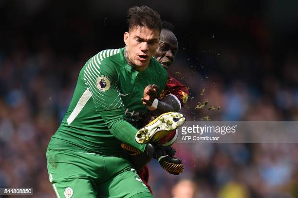 TOPSHOT Liverpool's Senegalese midfielder Sadio Mane is sent off for this challenge on Manchester City's Brazilian goalkeeper Ederson during the...
