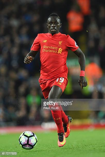 Liverpool's Senegalese midfielder Sadio Mane runs with the ball during the English Premier League football match between Liverpool and West Bromwich...