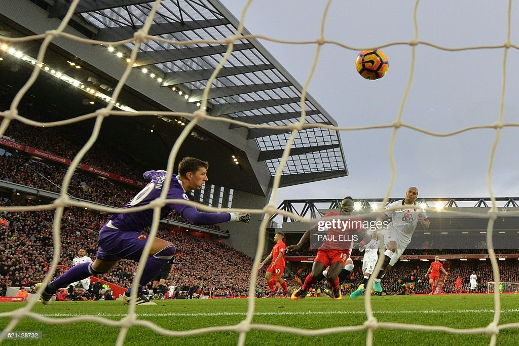 Liverpool's Senegalese midfielder Sadio Mane (2R) shoots past Watford's Romanian goalkeeper Costel Pantilimon (L) to score his second, and the team's fifth goal during the English Premier League football match between Liverpool and Watford at Anfield in Liverpool, north west England on November 6, 2016. / AFP / PAUL ELLIS / RESTRICTED TO EDITORIAL USE. No use with unauthorized audio, video, data, fixture lists, club/league logos or 'live' services. Online in-match use limited to 75 images, no video emulation. No use in betting, games or single club/league/player publications. /