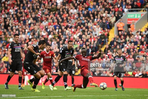 Liverpool's Senegalese midfielder Sadio Mane shoots to score the opening goal of the English Premier League football match between Liverpool and...