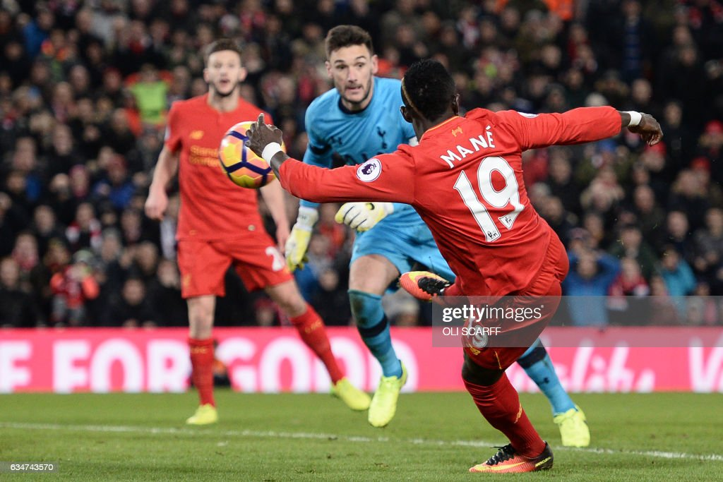 Liverpool's Senegalese midfielder Sadio Mane shoots to scores their second goal during the English Premier League football match between Liverpool and Tottenham Hotspur at Anfield in Liverpool, north west England on February 11, 2017. / AFP / Oli SCARFF / RESTRICTED TO EDITORIAL USE. No use with unauthorized audio, video, data, fixture lists, club/league logos or 'live' services. Online in-match use limited to 75 images, no video emulation. No use in betting, games or single club/league/player publications. /