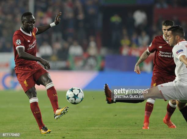 Liverpool's Senegalese midfielder Sadio Mane vies for the ball with Sevilla's midfielder Pablo Sarabia on November 21 2017 at the Ramon Sanchez...