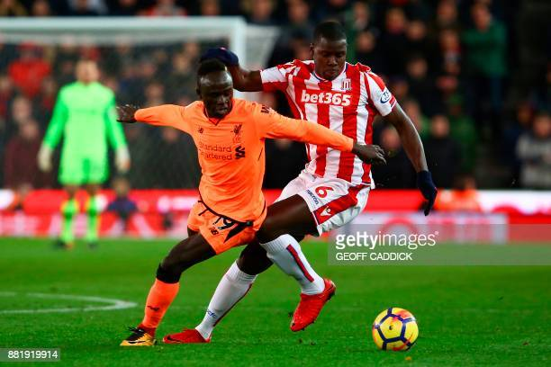 Liverpool's Senegalese midfielder Sadio Mane vies with Stoke City's French defender Kurt Zouma during the English Premier League football match...