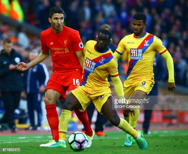 Liverpool's Serbian midfielder Marko Grujic vies with Crystal Palace's German defender Jeffrey Schlupp during the English Premier League football...
