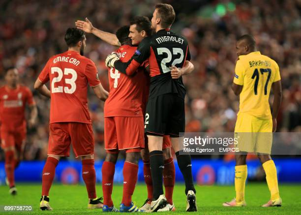 Liverpool's Simon Mignolet celebrates after the final whistle with team mates