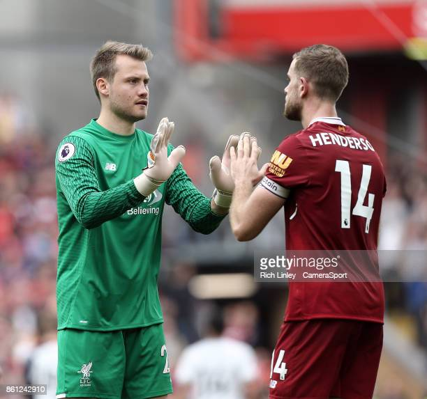 Liverpool's Simon Mignolet greets Jordan Henderson at the final whistle during the Premier League match between Liverpool and Manchester United at...