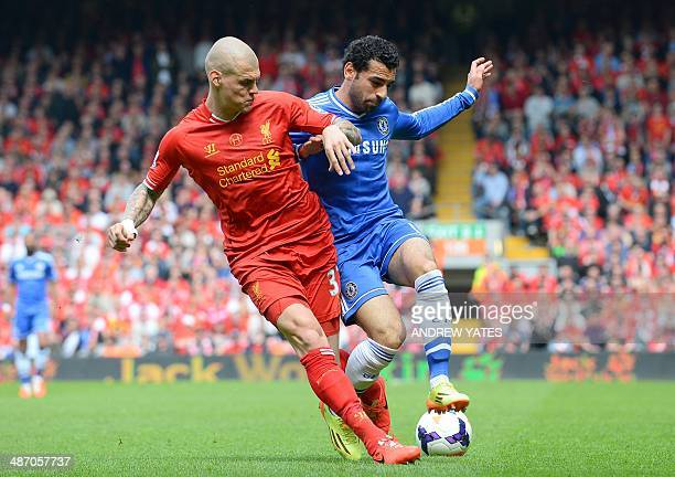 Liverpool's Slovakian defender Martin Skrtel vies for the ball with Chelsea's Egyptian midfielder Mohamed Salah during the English Premier League...
