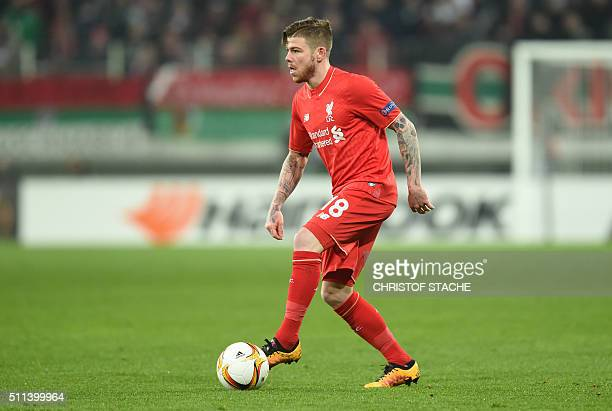 Liverpool's Spain defender Alberto Moreno plays the ball during the UEFA Europa League Round of 32 football match between FC Augsburg and Liverpool...