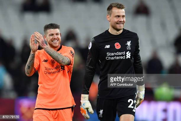 Liverpool's Spanish defender Alberto Moreno and Liverpool's Belgian goalkeeper Simon Mignolet cheer after winning the English Premier League football...