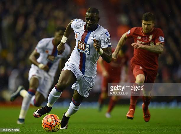 Liverpool's Spanish defender Alberto Moreno chases Crystal Palace's Frenchborn Congolese midfielder Yannick Bolasie as he runs with the ball during...