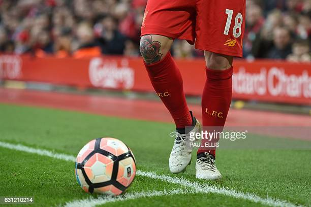 Liverpool's Spanish defender Alberto Moreno prepares to take a corner during the English FA Cup third round football match between Liverpool and...