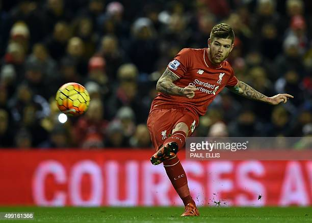 Liverpool's Spanish defender Alberto Moreno takes a freekick during the English Premier League football match between Liverpool and Swansea City at...