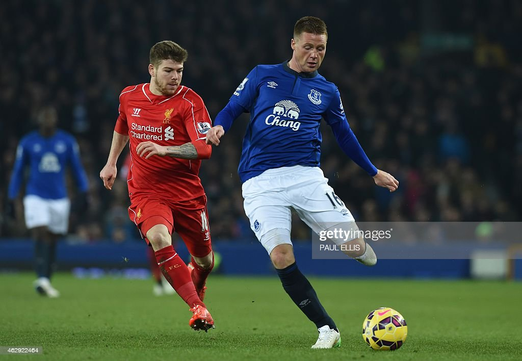Liverpool's Spanish defender Alberto Moreno (L) vies with Everton's Scottish-born Irish midfielder <a gi-track='captionPersonalityLinkClicked' href=/galleries/search?phrase=James+McCarthy+-+Soccer+Player&family=editorial&specificpeople=8984734 ng-click='$event.stopPropagation()'>James McCarthy</a> (R) during the English Premier League football match between Everton and Liverpool at Goodison Park in Liverpool on February 7, 2015. USE. No use with unauthorized audio, video, data, fixture lists, club/league logos or live services. Online in-match use limited to 45 images, no video emulation. No use in betting, games or single club/league/player publications.