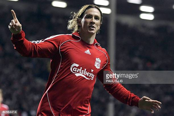 Liverpool's Spanish forward Fernando Torres celebrates after scoring the second goal during their UEFA Champions League quater final second leg...