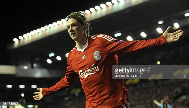 Liverpool's Spanish forward Fernando Torres celebrates after scoring the fourth goal during their UEFA Europa League Quarter Final Second Leg...