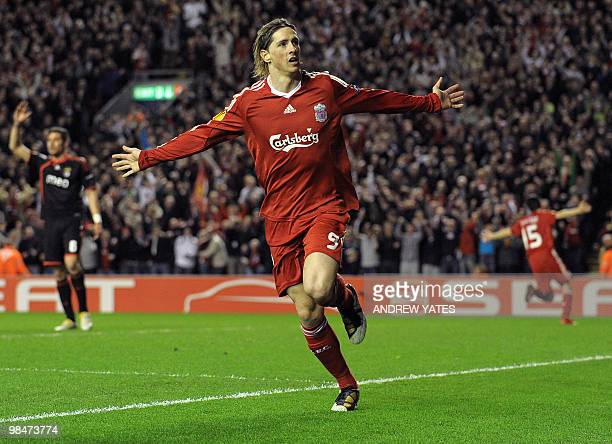 Liverpool's Spanish forward Fernando Torres celebrates after scoring the third goal during their UEFA Europa League Quarter Final Second Leg football...