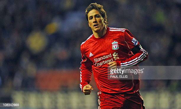 Liverpool's Spanish forward Fernando Torres celebrates scoring the opening goal of the English Premier League football match between Wigan Athletic...