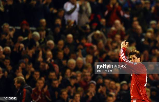 Liverpool's Spanish forward Fernando Torres looks back as he is substituted during their English Premier League football match against Chelsea at...