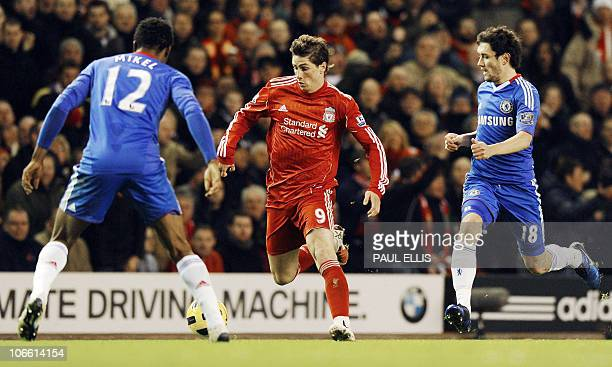 Liverpool's Spanish forward Fernando Torres runs with the ball against Chelsea during their English Premier League football match at Anfield in...