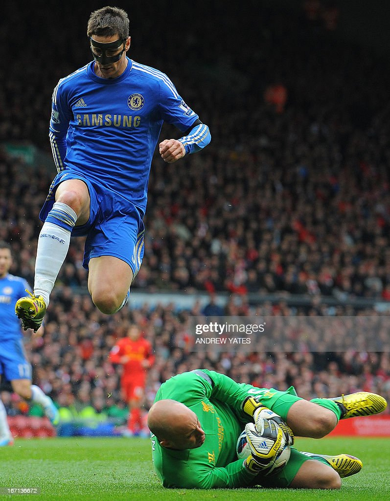 "Liverpool's Spanish goalkeeper Jose Reina (R) saves from Chelsea's Spanish striker Fernando Torres (L) during the English Premier League football match between Liverpool and Chelsea at the Anfield stadium in Liverpool, northwest England, on April 21, 2013. USE. No use with unauthorized audio, video, data, fixture lists, club/league logos or ""live"" services. Online in-match use limited to 45 images, no video emulation. No use in betting, games or single club/league/player publications."