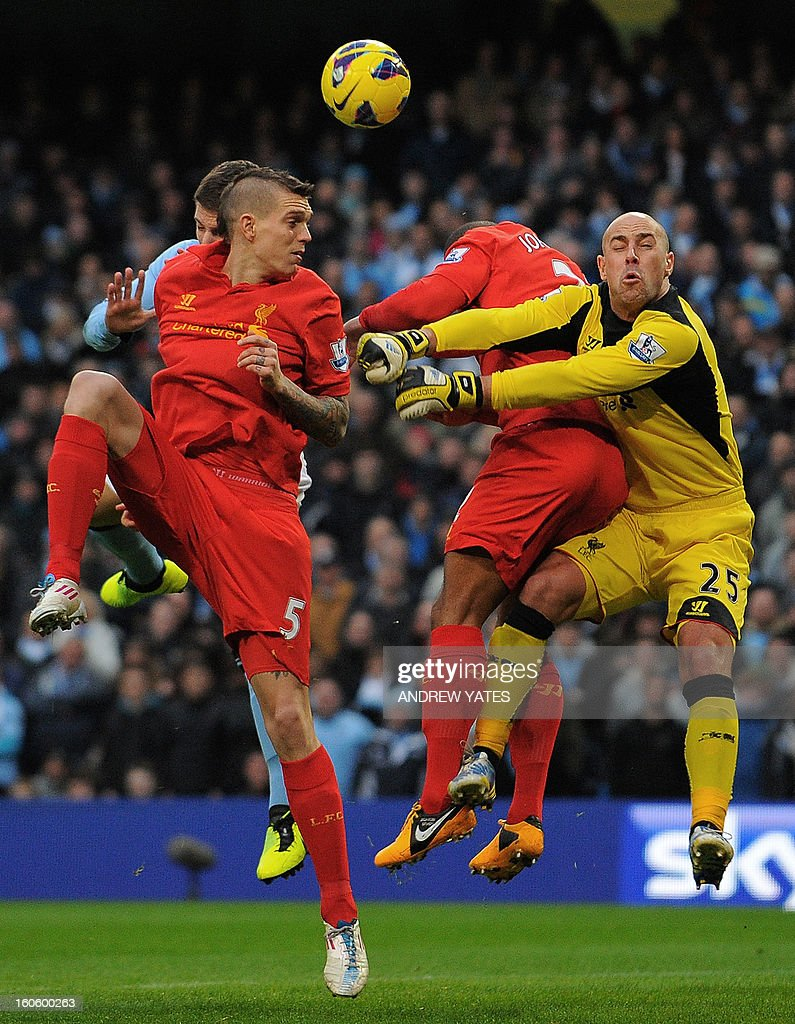 "Liverpool's Spanish goalkeeper Pepe Reina (R) attempts to clear the ball during the English Premier League football match between Manchester City and Liverpool at The Etihad stadium in Manchester, north-west England on February 3, 2013. USE. No use with unauthorized audio, video, data, fixture lists, club/league logos or ""live"" services. Online in-match use limited to 45 images, no video emulation. No use in betting, games or single club/league/player publications."