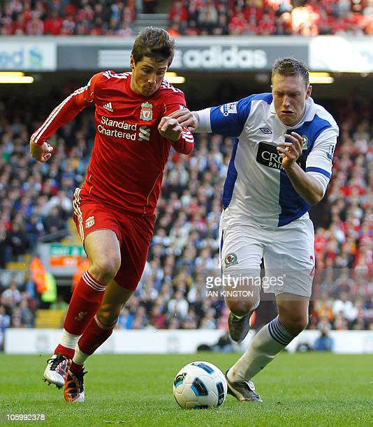 Liverpool's Spanish player Fernando Torres vies with Blackburn Rovers Phil Jones during a Premier League match at Anfield in Liverpool England on...